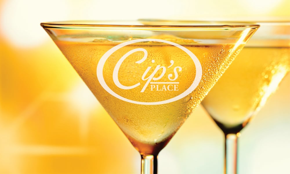Martini glass with the Cip's Place logo on it.