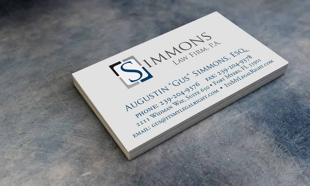 Simmons Law Firm, P.A. business cards laying on table.