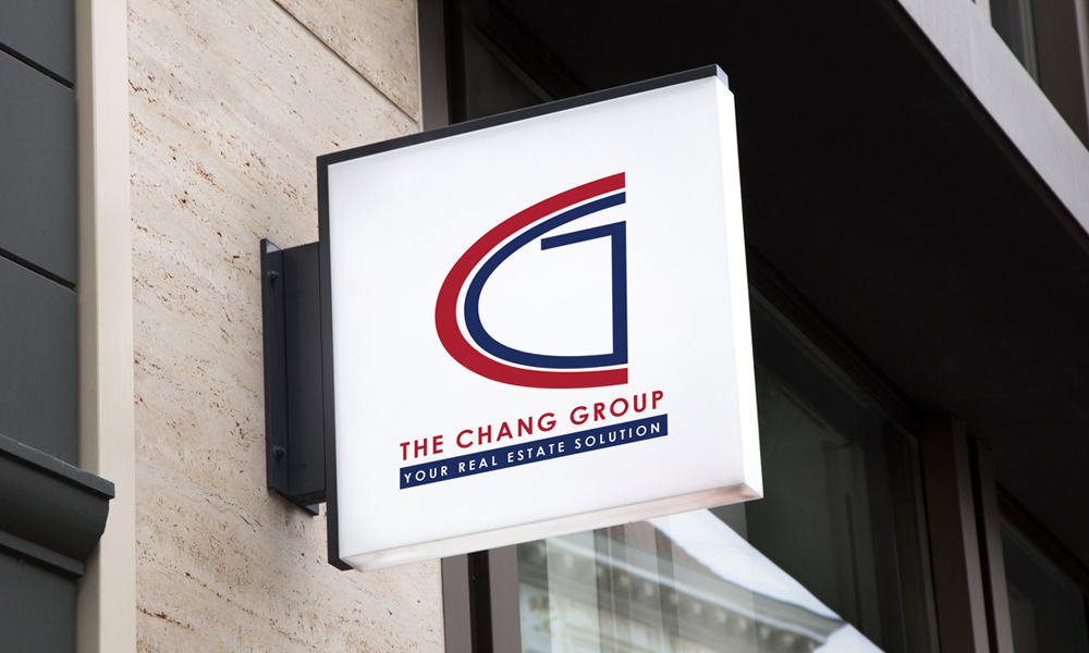 Sign attached to building displaying the chang group logo.